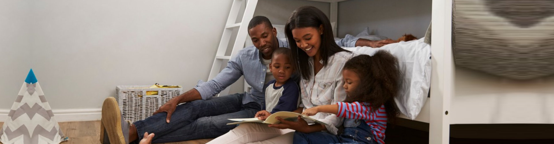 parents reading story to children in the bedroom